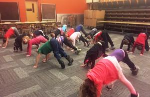 Kindergartners practice yoga stretches